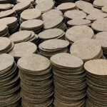 thousands of laser cut hessian circles
