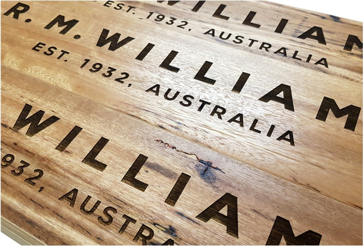 rm williams engraved wood close-up