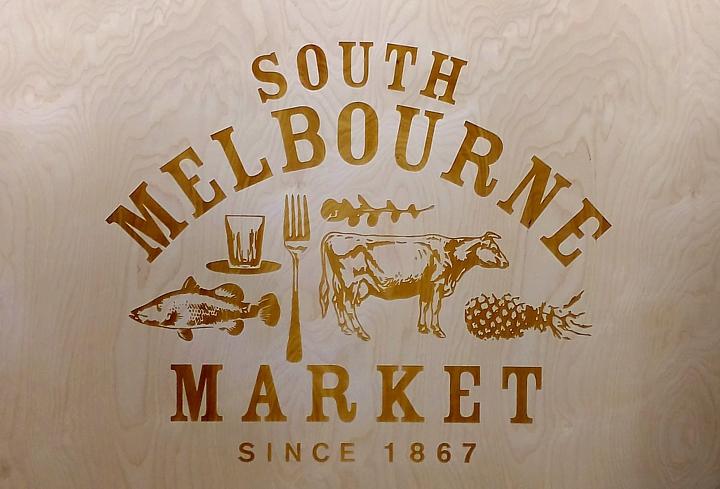 engraved wooden sign south melbourne market